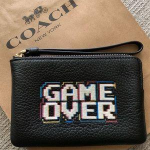 Coach Pac-Man wristlet